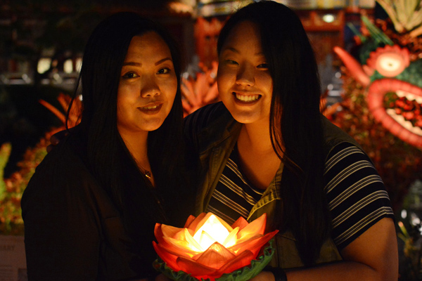Take a photo with a light-up lotus blossom at the China Pavilion in Epcot